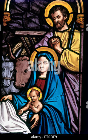 Stained glass window in all saints church ; Connor ; Nilgiris ; Tamil Nadu ; India - Stock Photo