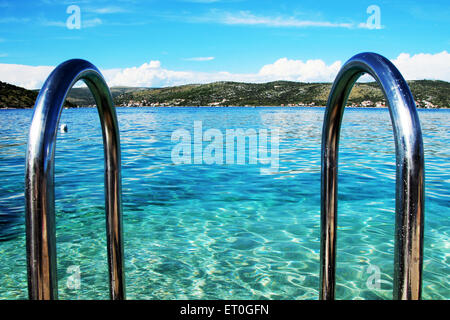 Pool handrails next to the sea - Stock Photo