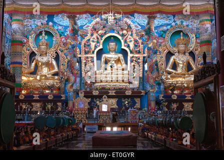 Statues of Padmasambhav Budhushtrayamnni and Amitay in biggest Namdroling monastery at Kushal nagar ; District Coorg - Stock Photo