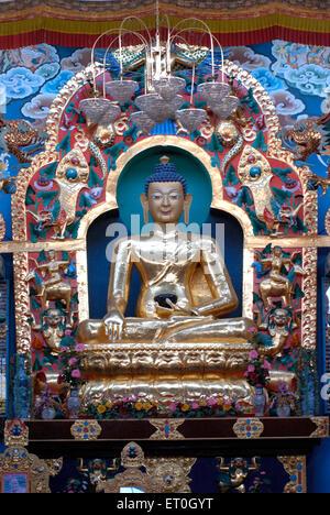 Statue of  Budhushtrayamnni in biggest Namdroling monastery at Kushal nagar District Coorg ; Karnataka ; India - Stock Photo