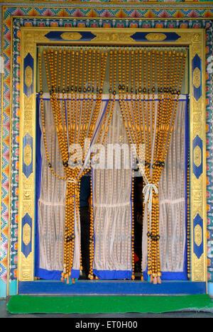 Colourful beaded curtain of Biggest Namdroling monastery at Kushal nagar District Coorg ; Karnataka ; India - Stock Photo