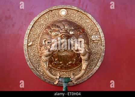 Dragon face door handle at Biggest Namdroling monastery at Kushal nagar District Coorg ; Karnataka ; India - Stock Photo