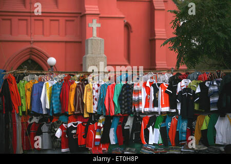 Shirts of various colours lined for sale on roadside stall in Ranchi city capital of Jharkhand India - Stock Photo