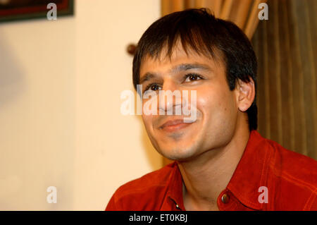 Indian film personality Vivek Oberoi smiling during press conference in Bombay Mumbai ; Maharashtra ; India NO MR - Stock Photo