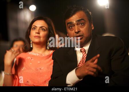 Mukesh Ambani with wife Neeta Ambani ; Chairman and Managing Director of Reliance Industries Limited RIL Bombay - Stock Photo