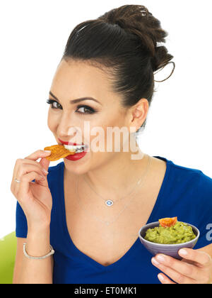 Beautiful Attractive Young Hispanic Woman Holding A Small Bowl Of Homemade Guacamole Against A White Background - Stock Photo