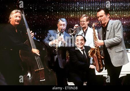 FILE - A file picture dated 04 March 1986 shows musicians (L-R) James Last, Hugo Strasser, Hazy Osterwald, Max Greger - Stock Photo