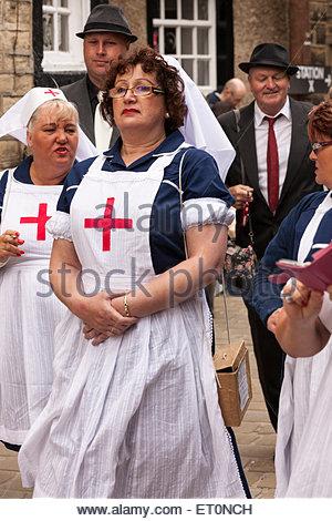 Women dressed as nurses . Haworth 1940s Weekend . Haworth West Yorkshire England UK - Stock Photo