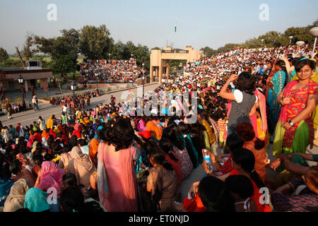 Crowds gathered to watch changing of guard ceremony at Wagah border ; Amritsar ; Punjab ; India NO MR - Stock Photo