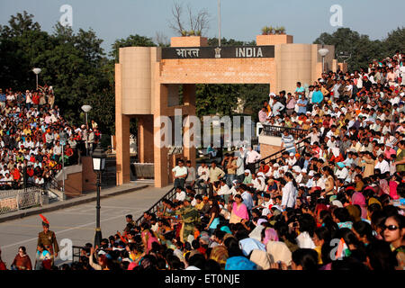 Crowds gathered to watch changing of guard ceremony at Wagah border ; Amritsar ; Punjab ; India - Stock Photo