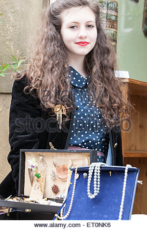 Young woman with jewellery stall at Haworth 1940s Weekend Haworth West Yorkshire England UK - Stock Photo