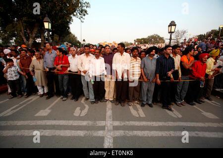 Crowds gathered to watch changing of guard ceremony at Wagah border ; Amritsar ; Punjab ; India NO MR - Stock Photo