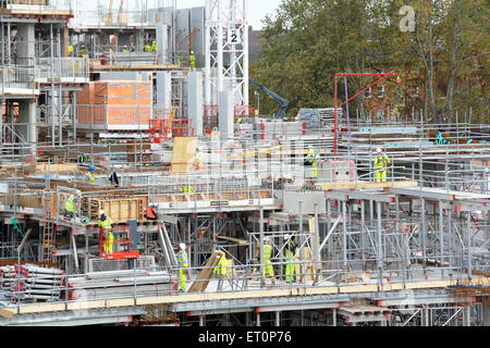 Construction site modular formwork and scaffolding units in use on construction of building superstructure South - Stock Photo