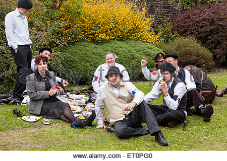 People in 'Free French' costumes having a picnic Haworth 1940s Weekend Haworth West Yorkshire England UK - Stock Photo