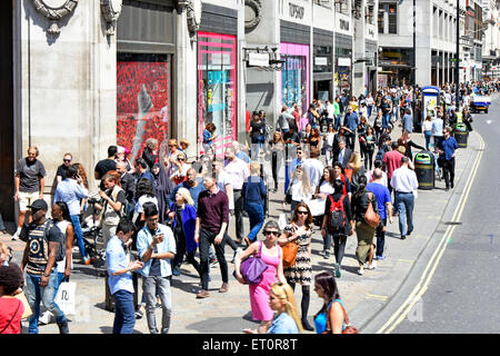 Shopping in a busy Oxford Street London West End outside Topshop store on a warm summer day England UK England UK - Stock Photo