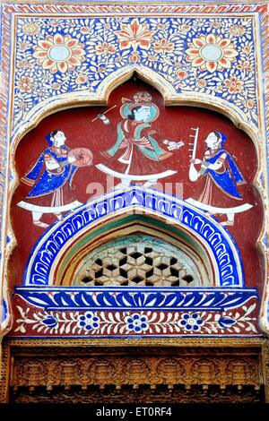 Paintings of lord krishna dancing with gopika on wall of haveli Fatehpur  ; Shekhawati ; Rajasthan ; India - Stock Photo