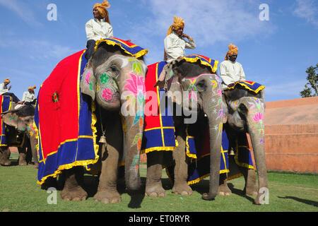 Mahouts on elephant ; Jaipur ; Rajasthan ; India - Stock Photo