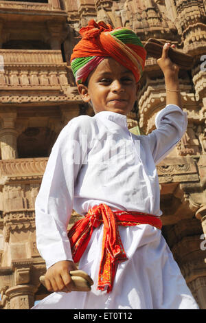 Boy playing cymbal ; Deval ; Mandore ; Jodhpur ; Rajasthan ; India MR#769L - Stock Photo