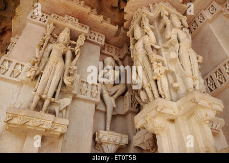 Statues engraved on pillar ; Deval ; Mandore ; Jodhpur ; Rajasthan ; India - Stock Photo