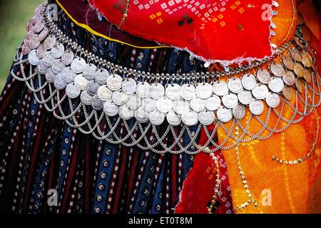 Woman wearing jewellery ; Rajasthan ; India - Stock Photo