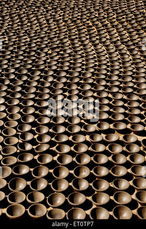 Oil lamps in a row ; Rajasthan ; India - Stock Photo
