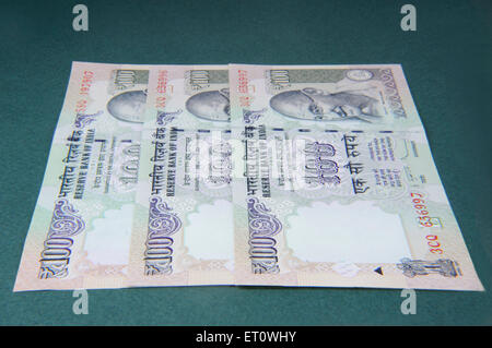 concept of Indian currency one hundred rupee notes - Stock Photo