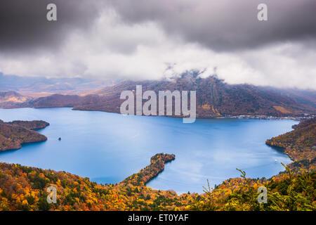 Nikko, Japan at Lake Chuzenji and Mt. Nantai in the autumn. - Stock Photo