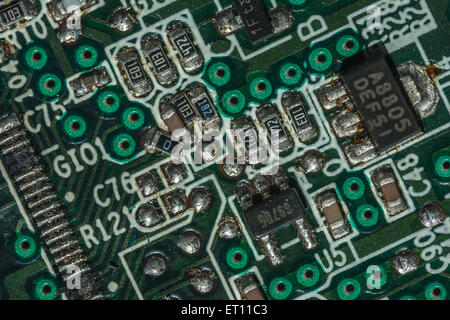 Macro-photo of printed circuit components on a PC motherboard. Wiring inside computer. - Stock Photo