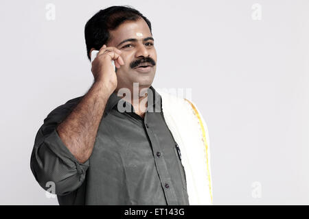 South Indian Man Talking on Mobile Phone India Asia MR#790E
