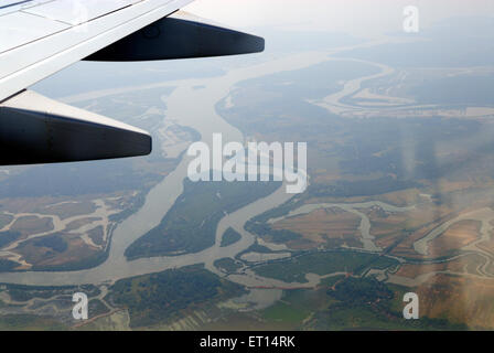 Aerial view of river and aircraft wing ; Goa ; India - Stock Photo