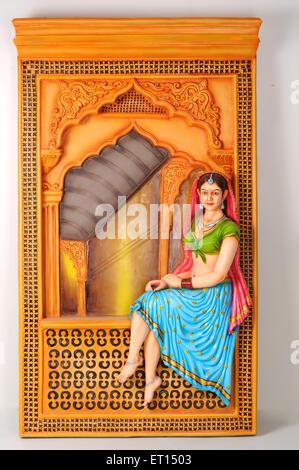 Clay figurine ; statue of rajasthani young girl sitting on jharoka - Stock Photo