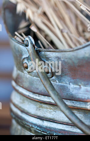 Bunch dried ears in a blue ceramic vase - Stock Photo