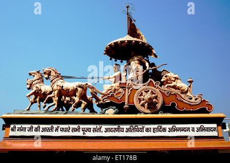 Statue shree krishna arjuna in chariot at swarg ashram ; Rishikesh ; Uttaranchal Uttarakhand ; India 2010 - Stock Photo