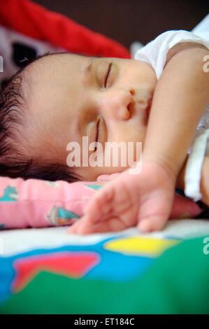 Baby boy child sleeping with hand on lips MR#736LA - Stock Photo