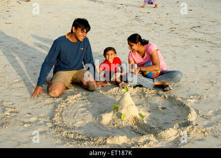 Sand castle making by Indian parents with child , Andaman and Nicobar Islands , India - MR#736J&K&L - Stock Photo