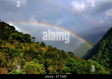 Rainbow on Cloudy Sky Sikkim India Asia - Stock Photo