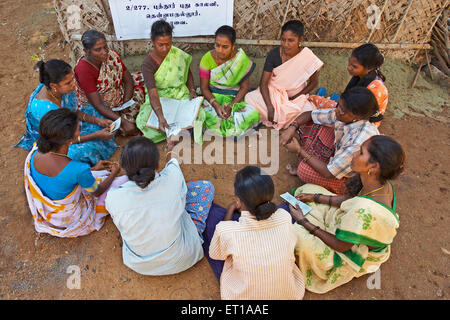 Ladies volunteers of NGO Chinmaya Organization of Rural Development CORD collecting contribution - Stock Photo