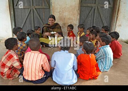 Teacher in rural school with children social initiative started by NGO Chinmaya Organization of Rural Development - Stock Photo