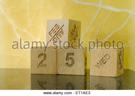 Wooden cubes with numbers and months - Stock Photo