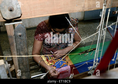 Woman Weaving Saree on Handloom at Maharashtra India Asia - Stock Photo