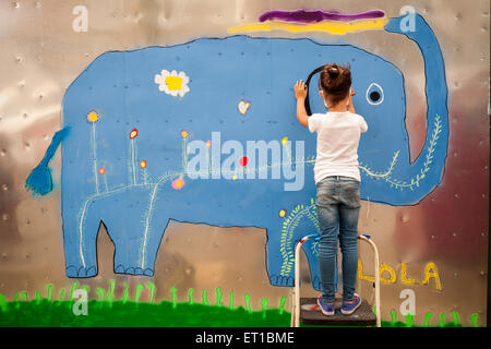6 year old girl paints her mural during the annual Bushwick Collective Block Party on Saturday, June 6, 2015. Music - Stock Photo