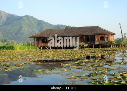 Abandoned house boat in dal lake Srinagar Jammu and Kashmir India Asia - Stock Photo