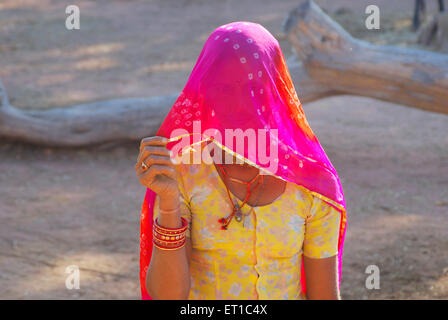 Rajasthani young woman in veil ; Mathania ; Jodhpur ; Rajasthan ; India - Stock Photo