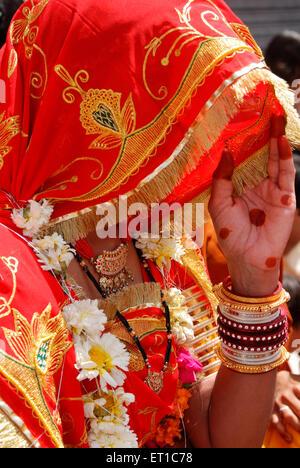Portrait of newly married Rajasthani Marwari woman in veil on occasion of Gangaur ; Jodhpur ; Rajasthan ; India - Stock Photo