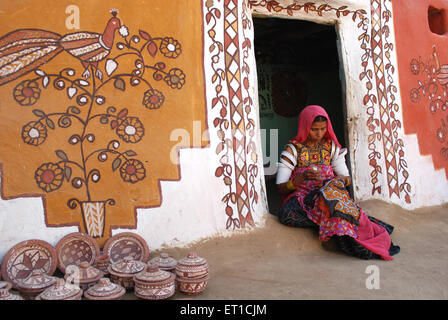 Lady doing embroidery work on cloth  ; Khuri Khuhri ; Jaisalmer ; Rajasthan ; India NOMR - Stock Photo