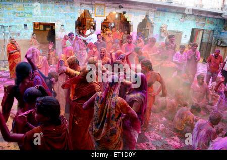 People playing with gulal on holi festival at ghanshyam ji temple ; Jodhpur ; Rajasthan ; India - Stock Photo