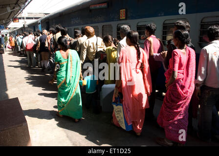 Travellers in queue to board a train on railway station ; Ahmedabad ; Gujarat ; India - Stock Photo