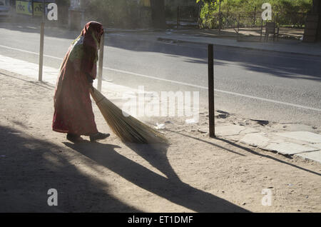 Sweeper cleaning road in Jaipur at Rajasthan India - Stock Photo