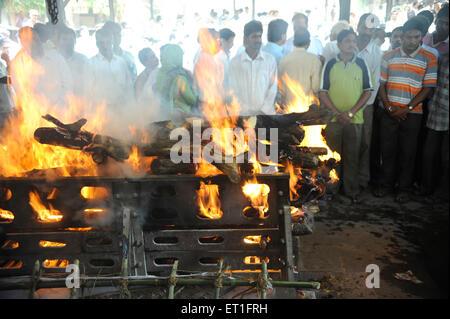 Funeral of Anti Terrorism Squad Chief Hemant Karkare killed by terrorist attack in Bombay Mumbai ; Maharashtra - Stock Photo