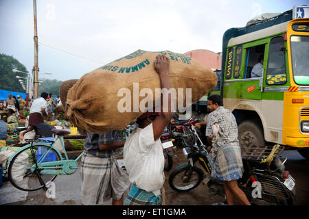 Man carrying jute sack ; Thanjavur ; Tamil Nadu ; India - Stock Photo